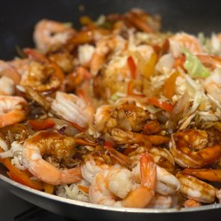 Add cooked shrimp then pour the sauce over & toss well