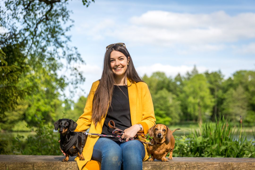 Click to discover why the National Trust dog walks at Stowe make an incredible day out with your dog. Picture shows our two dachshunds & Sarah Baxter from Twilight Bark UK at the Octagon Lake at Stowe.