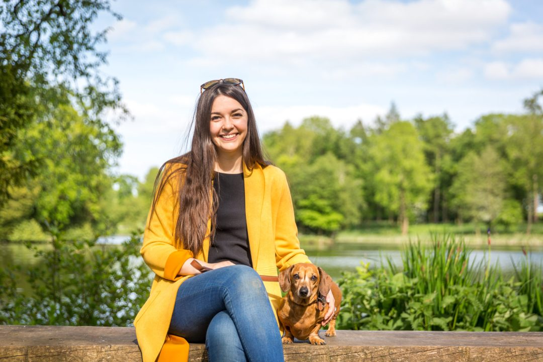 Click to discover why the National Trust dog walks at Stowe make an incredible day out with your dog. Picture shows Ted the dachshund & Sarah Baxter from Twilight Bark UK at the Octagon Lake at Stowe.