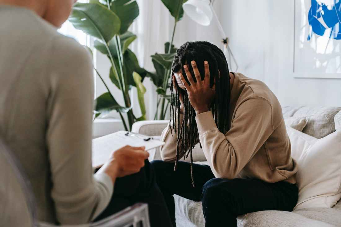 stressed black man with dreadlocks in psychological office dealing with setting boundaries