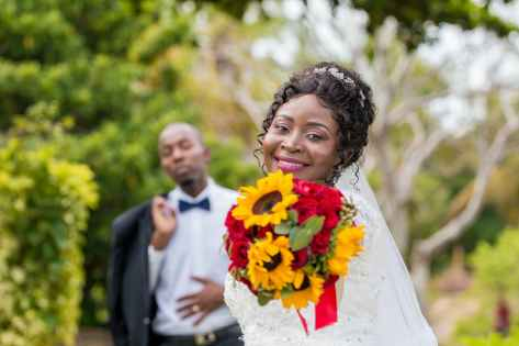photo of woman holding bouquet of flowers