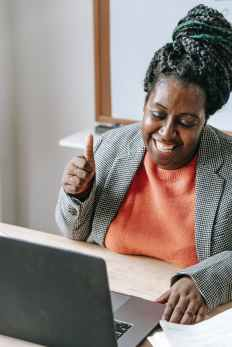glad older black woman having video call and showing thumb up her growth is beautiful