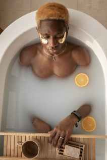 relaxed black man in bath during skincare routine building resilience