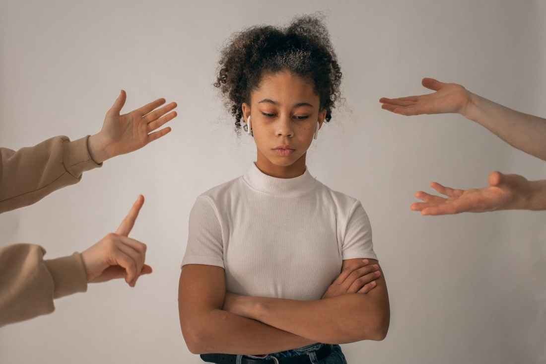 faceless people scolding discontent black girl