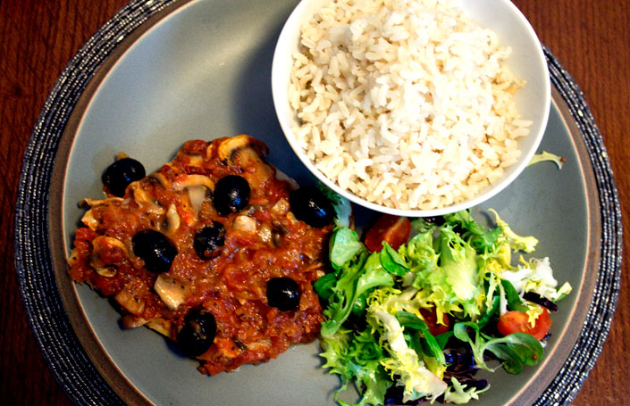 italian baked fish with brown rice and a little salad