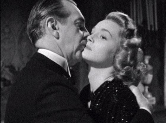 Raymond Massey and Patricia Neal