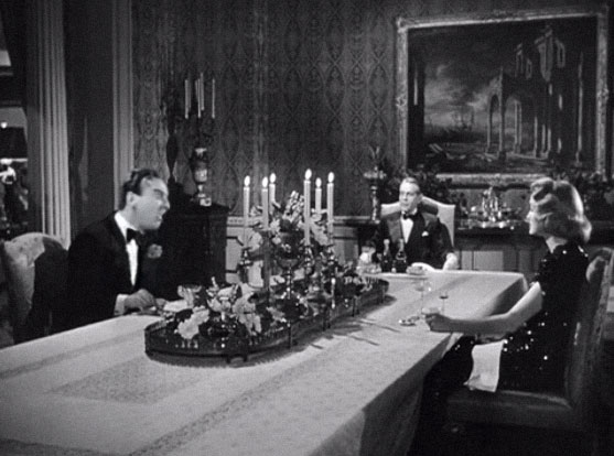 David Niven as Bertie Wooster acting like a cold-hearted giant of the business world.