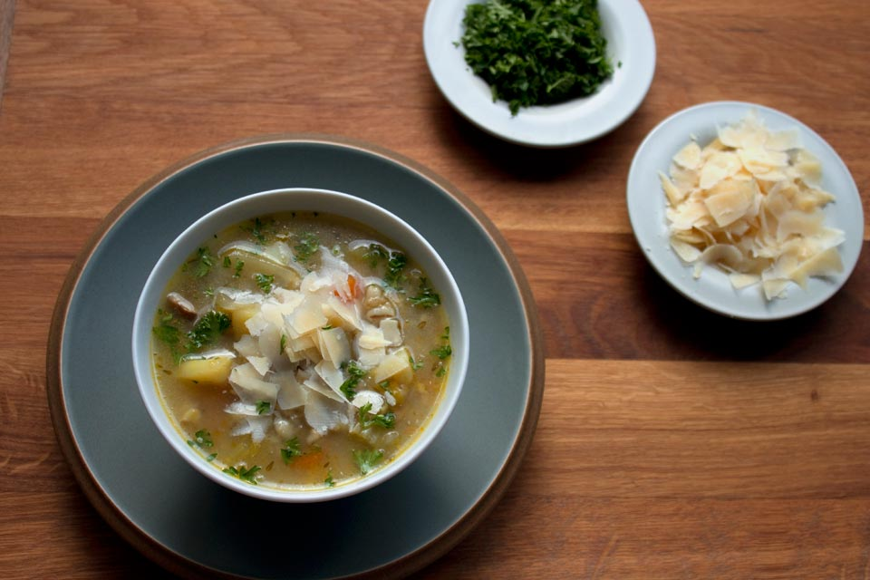 Vegetable broth with vegetarian parmesan, Gran Kinara - with extra parsley and cheese for topping.
