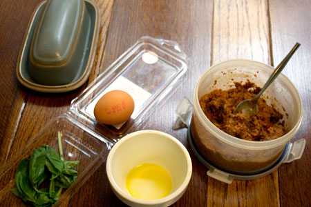 ingredients for egg baked in tapenade with basil