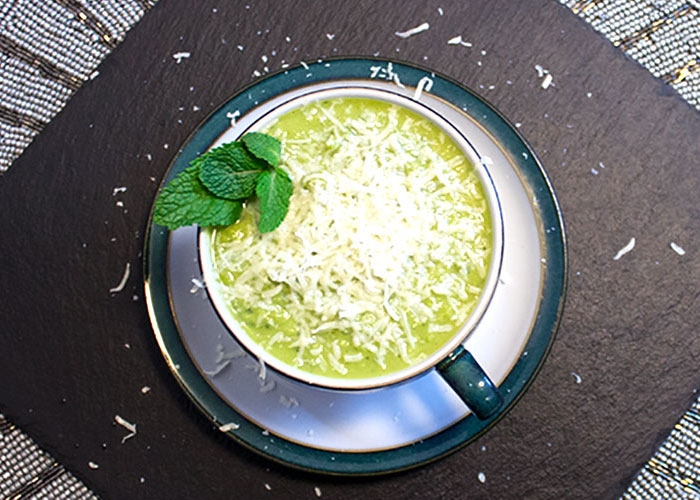 Easy Peasy Pea Mint soup topped with some grated Parmesan cheese.