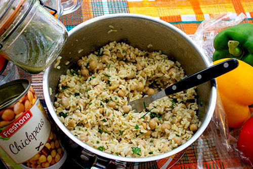 Mix half the dressing into the rice and the chickpeas.