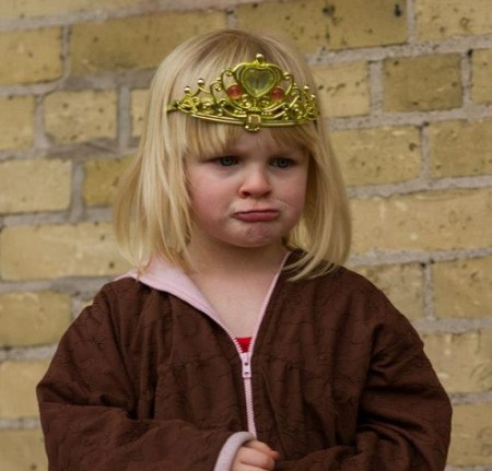 Little girl in tiara pouting