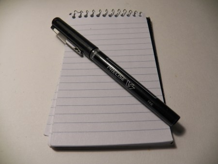 Pen and blank notebook