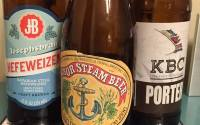 Three beer bottles: Josephsbrau Heffeweizen, Anchor Steam Beer, and KBC Porter.