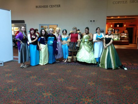 Disney princess cosplayers pose for a photo.