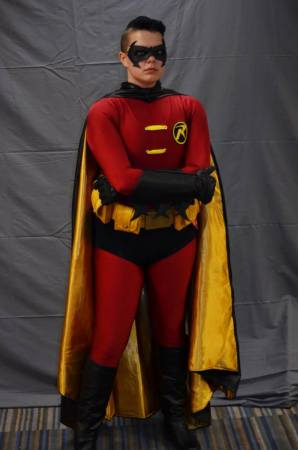 Photo of trans cosplayer Tim Fox as Robin the Boy Wonder