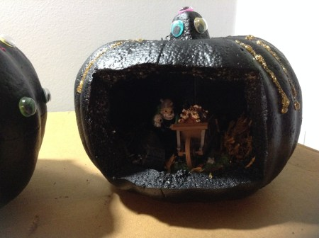 Googly eyes and glitter glue have decorated the outside of the pumpkin.