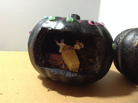 Used glitter glue and sticky googly to decorate the outside of the pumpkin.