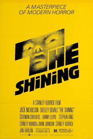 The Shining poster, all in yellow with black letters: A Masterpiece of Modern Horror The Shining (which has a creepy face peering through the black lettering) with the stars and Kubrick listed below