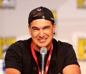 Patrick Warburton makes a face at the microphone
