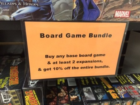 A sign about some of the board game deals at River Quest