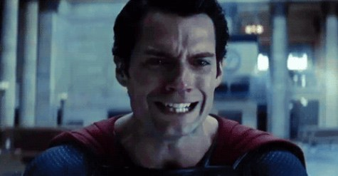 Henry Cavill as Superman, wearing a pained expression