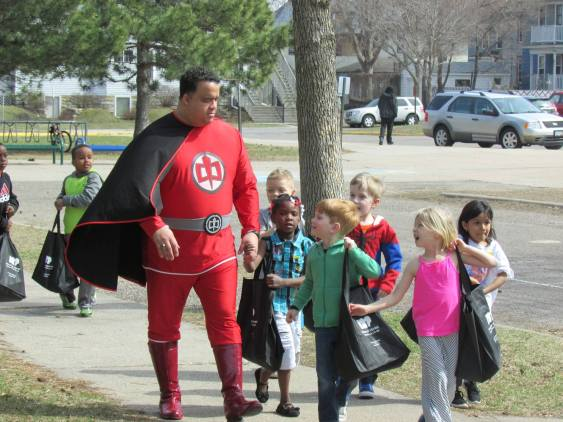 "Captain HQB helps""Hallie's Heroes"" deliver donations to the Food Shelf"