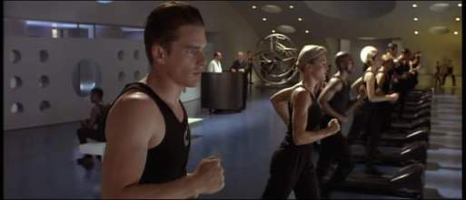 The team running at the gym, on treadmills. Ethan Hawke is in the forefront.