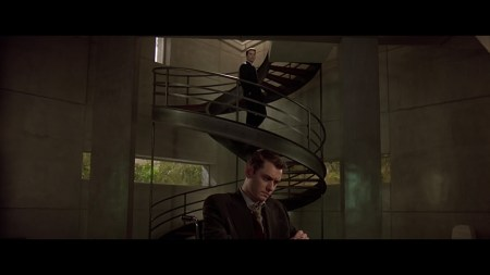 Jude Law downstairs in the house and Ethan Hawke is walking down the DNA-helix staircase behind him. Lots of greys and browns used in the film.