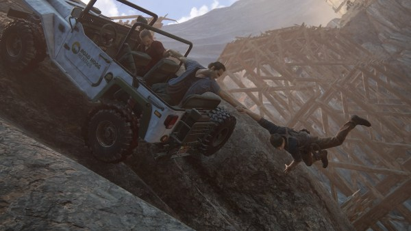 A Jeep drives over rough terrain; one character is falling out