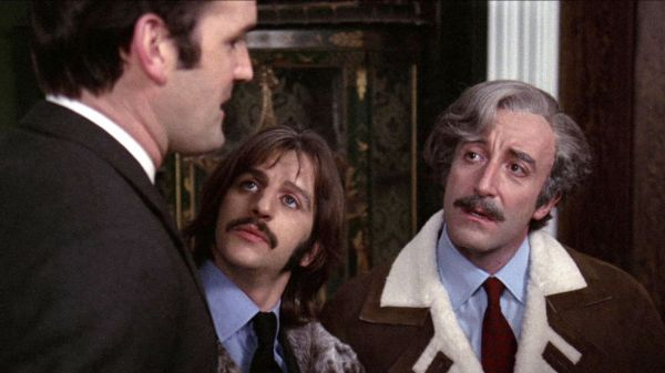 Screenshot of John Cleese, Ringo Starr, and Peter Sellers in conversation.