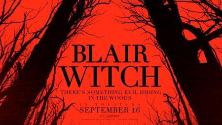 Blair Witch promotional image featuring black trees on a red background and the words BLAIR WITCH / THERE'S SOMETHING EVIL HIDING IN THE WOODS / SEPTEMBER 16