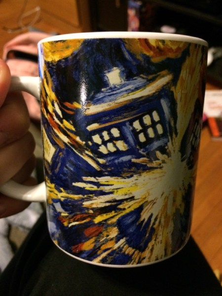 "A coffee mug featuring the fictional VIncent Van Gogh painting ""The Pandorica Opens,"" depicting the TARDIS from Doctor Who"
