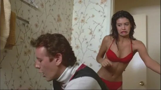 Phoebe Cates in a red bikini