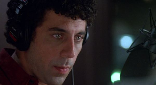 Eric Bogosian as Barry, with headphones on