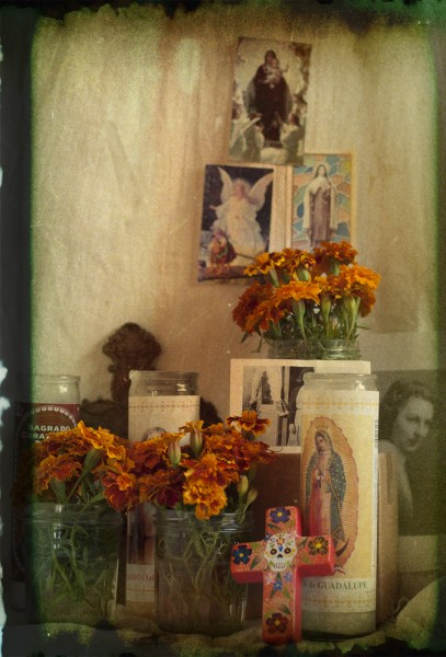 A typical ofrenda, with photos, flowers, and candles.