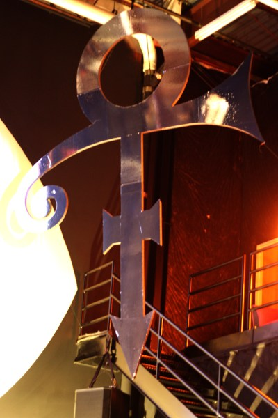"A large, hanging decoration of Prince's ""male/female"" symbol"