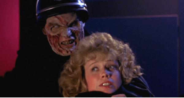Blonde struggling with zombie cop in Night of the Comet.