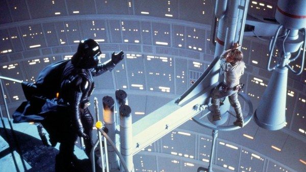 Darth Vader reaching out to Luke Skywalker.