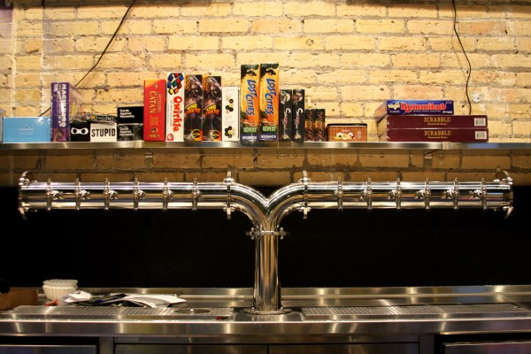 A collection of board games above Byte's taps