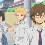 The three protagonists of Daily Lives of High School Boys standing together on the street; the boy on the left has a frustrated expression on his face, and the other two boys have a bored expression