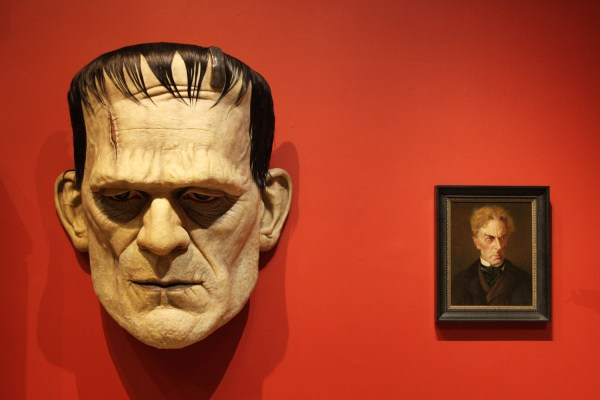 A giant head of Frankenstein's monster and a portrait of Dr. Frankenstein