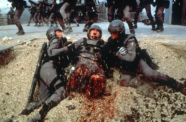 Michael Ironside being pulled from a pit, missing his legs.