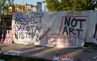 Banners protesting the installation of Scaffold at the Minneapolis Sculpture Garden