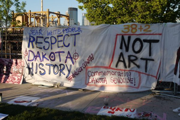 Banners protesting the installation of <i>Scaffold</i> at the Minneapolis Sculpture Garden