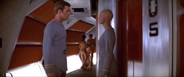 Decker (Stephen Collins) confronts Ilia (Persis Khambatta) in a corridor.