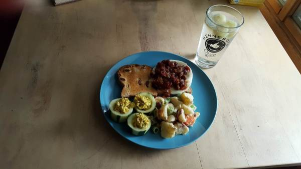 Chutney on toasted bread and provolone, cucumber cups, potato salad, and cucumber water.