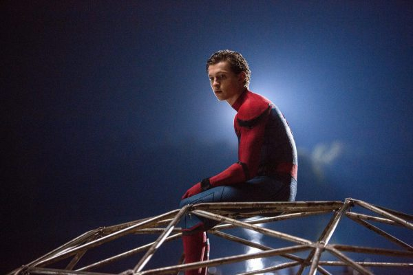 Peter sits on a playground in his suit