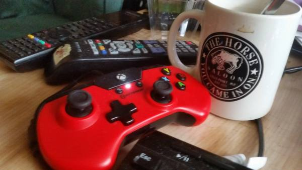 The X91 controller next to a coffee cup