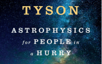 The cover of Neil DeGrasse Tyson's book Astrophysics for People in a Hurry, a young boy reads a book in front of a rainbow of stars.